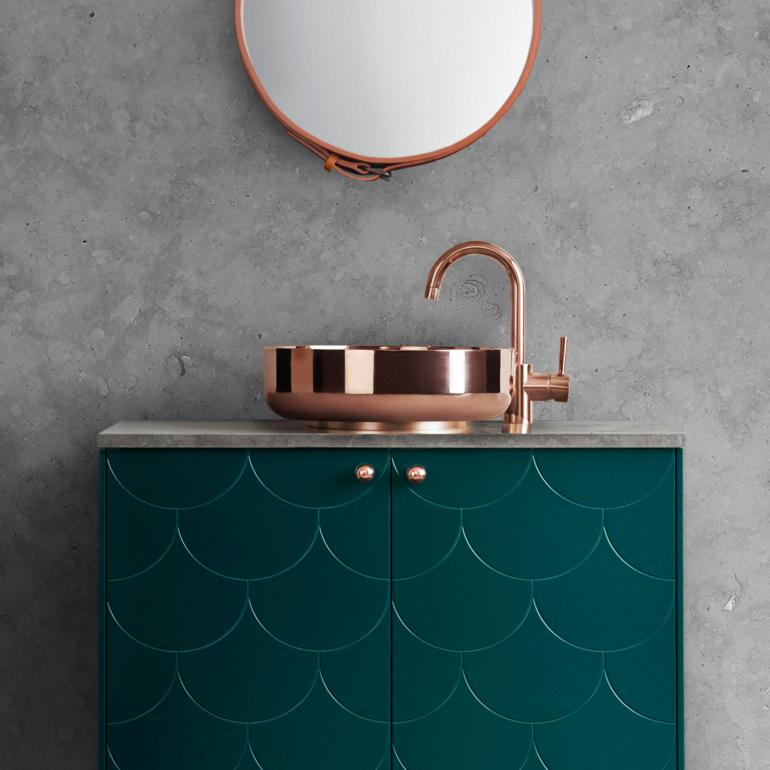 superfront-vanity-unit-bathroom-big-fish-pattern-bottle-green-copper-sink-tap-handle-limestone-top.jpg
